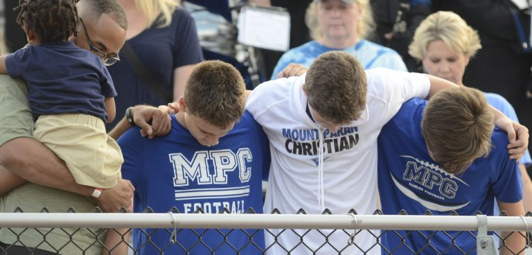MPCS high school boys in prayer