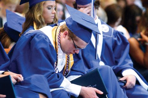 Who we are graduate praying